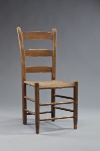A ladderback chair that was made by Richard Poynor.  The chair currently is in MESDA's collection.